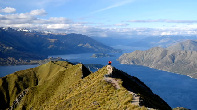 HD: Hikers couple summit on the top of Mountain at Mt. Roy's peak , wanaka new zealand