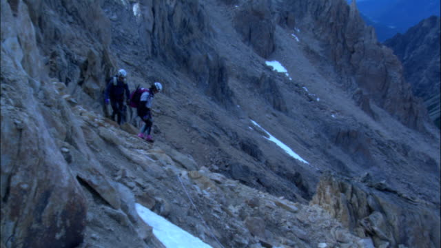 hikers descend a treacherous rocky slope. - provincial reconstruction team stock videos & royalty-free footage