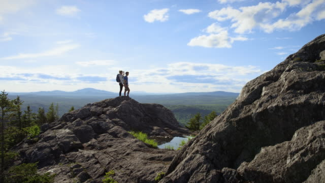 hikers having reached the top of a mountain - maine stock videos & royalty-free footage