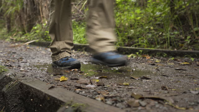 hikers muddy boots. - dirt track stock videos & royalty-free footage