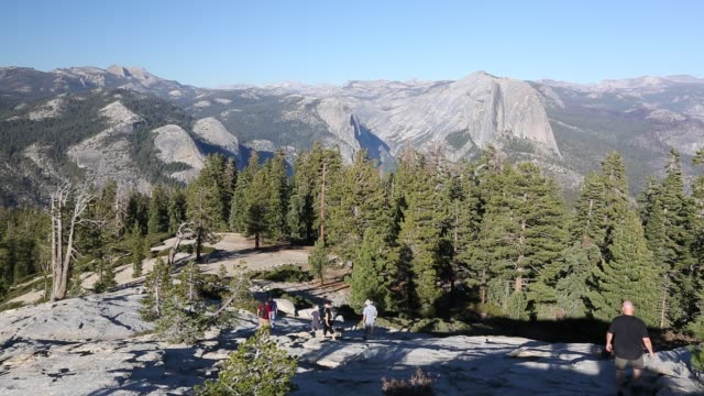 hikers on sentinel dome in yosemite national park, california, usa. - yosemite national park stock videos & royalty-free footage