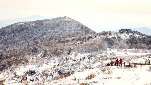 Hikers on snow-covered Mt. Deogyusan National Park (famous for backpacking and hiking)