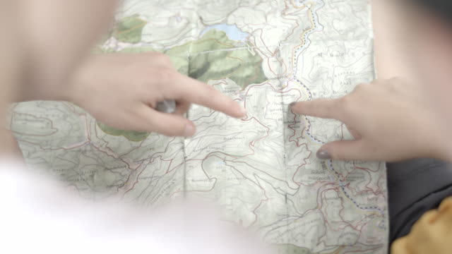 hikers reference paper map - guidance stock videos & royalty-free footage