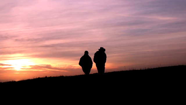 Hikers, silhouette at sunset.