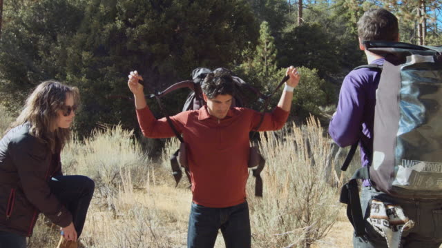 hikers strapping on backpacks - angeles national forest stock videos and b-roll footage
