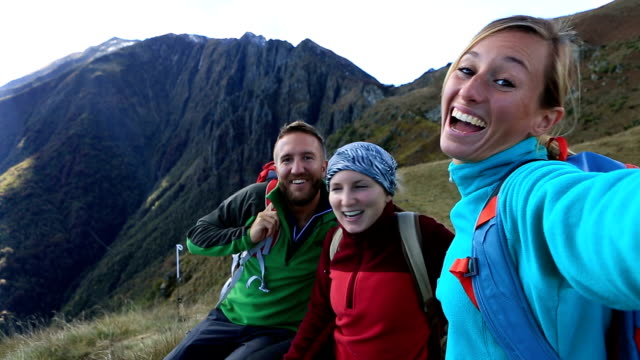 Hikers taking selfie on mountain top