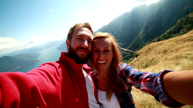 Hikers taking selfies in the mountains