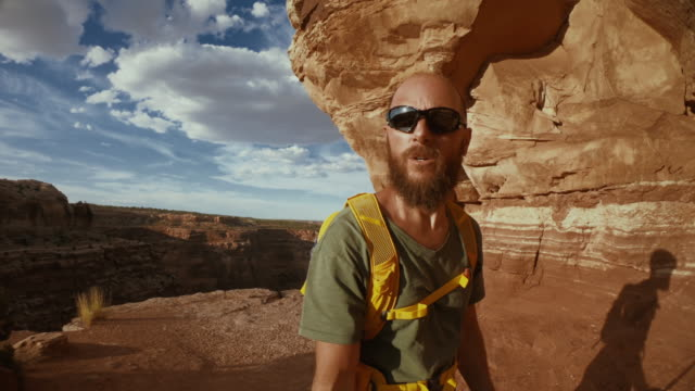 hiking adventures in canyonlands, shafer trail, moab - sunglasses stock videos & royalty-free footage