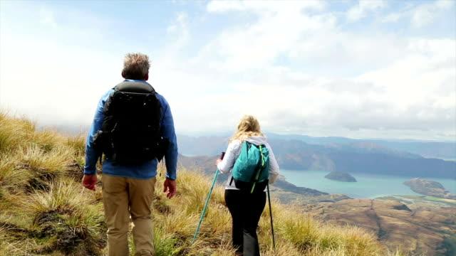 Hiking couple admire mountain view