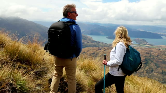 Hiking couple admire mountain view