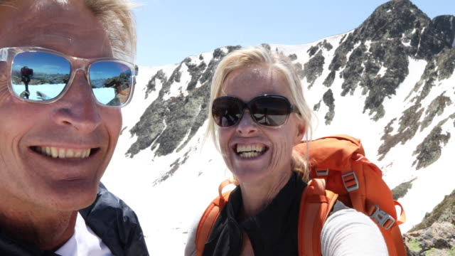 pov of hiking couple in snowy mountain landscape - beautiful people stock videos & royalty-free footage