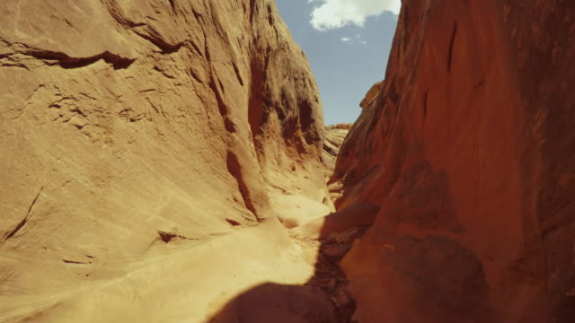 pov hiking in a slot canyon: grand staircase escalante national monument - red rocks stock videos & royalty-free footage