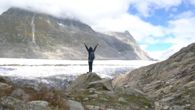 hiking in aletsch glacier in the switzerland - ice sheet stock videos and b-roll footage