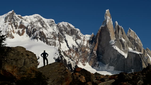 hiking in argentine patagonia with cerro torre - remote location video stock e b–roll