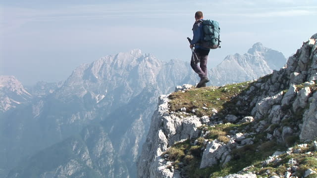 hd: hiking in mountains - mountain peak stock videos and b-roll footage