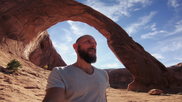 pov hiking in the colorado plateau: corona arch near moab - arches national park stock videos & royalty-free footage