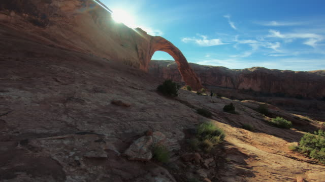 pov hiking in the colorado plateau: corona arch near moab - red rocks stock videos & royalty-free footage