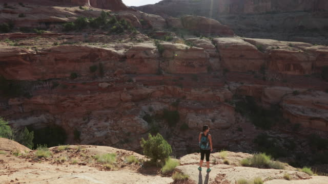 hiking in the colorado plateau: woman traveling alone - colorado plateau stock videos & royalty-free footage