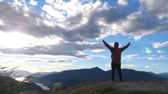 hiking man success claim at sunset - new zealand stock videos & royalty-free footage