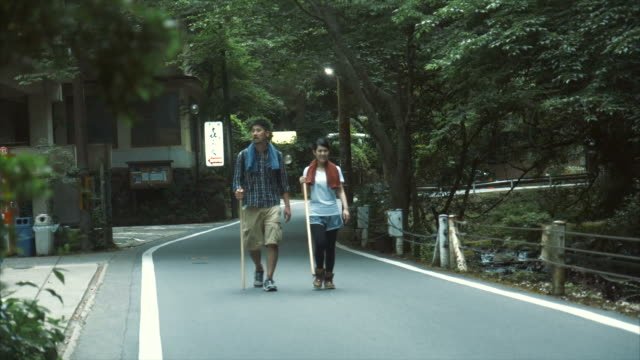 hiking on a road - lypsekyo16 stock videos and b-roll footage