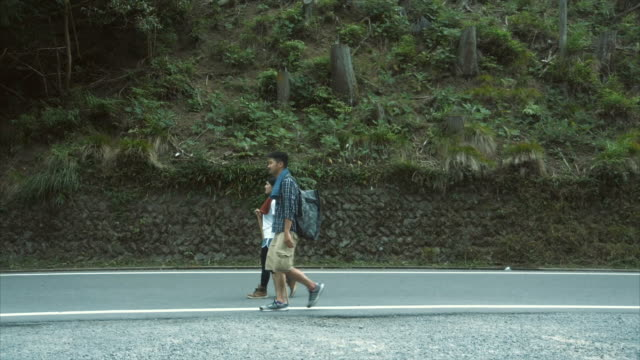 hiking on a road (slow motion) - lypsekyo16 stock videos and b-roll footage