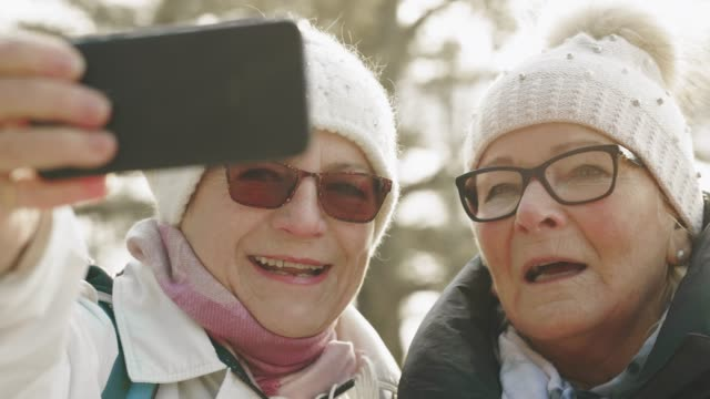 hiking senior couple are taking selfies - outdoor pursuit stock videos & royalty-free footage