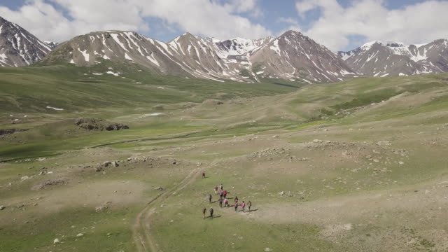 hiking to altai mountain in mongolia - independent mongolia stock videos & royalty-free footage