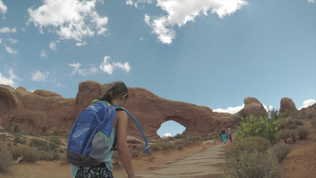 hiking up to arches formation - arch stock videos & royalty-free footage