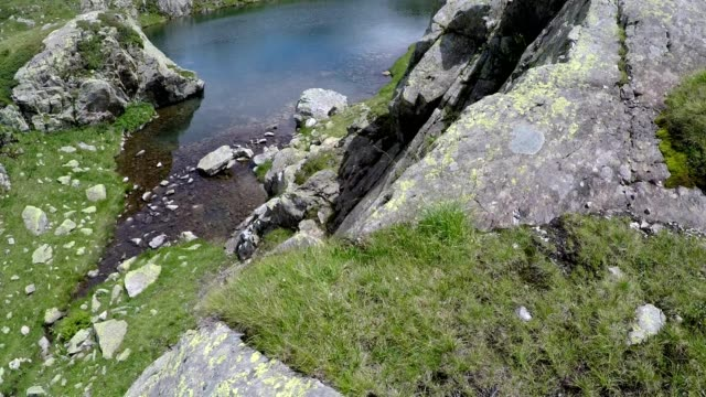hiking walking across flat glacial rock in the french alps in summer near chamonix, france - auvergne rhône alpes stock videos & royalty-free footage