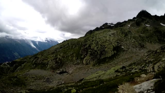 hiking walking over rocky mountain landscape in the french alps near chamonix - auvergne rhône alpes stock videos & royalty-free footage