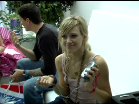 hilary duff at the xm satellite radio rocks the style villa day three at the sagamore hotel in film industry, florida on august 28, 2005. - 3日目点の映像素材/bロール