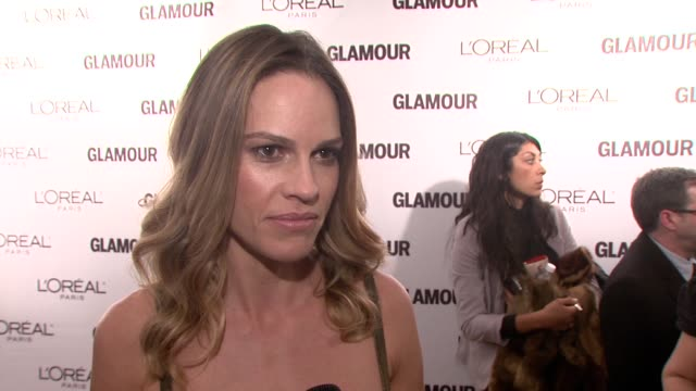 hilary swank on being out tonight and honoring donatella versace on how wearing a versace gown for the first time really changed her life launched... - hilary swank stock videos & royalty-free footage