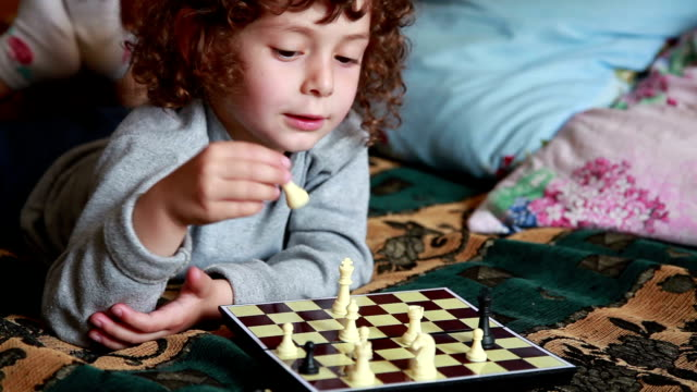 сhild playing chess - chess stock videos & royalty-free footage