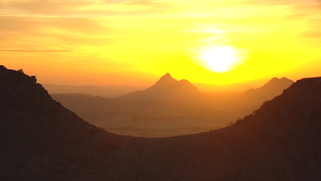 MS AERIAL Hill silhouette against sunrise in Chihuahuan Dessert in Big Bend Country / Texas, United States