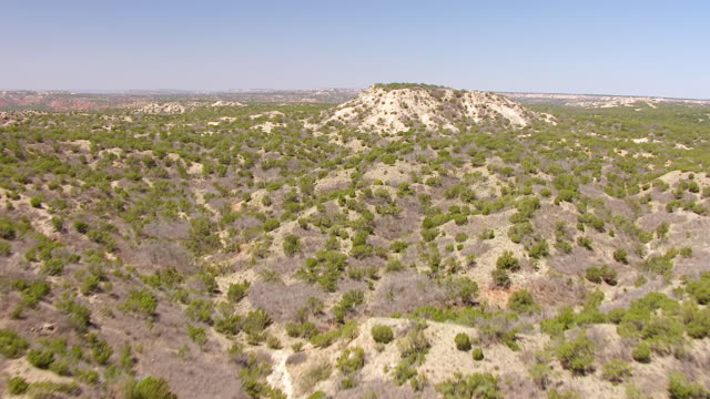 ws aerial hill to landscape of palo duro canyon in panhandle plains / texas, united states - plain stock videos & royalty-free footage