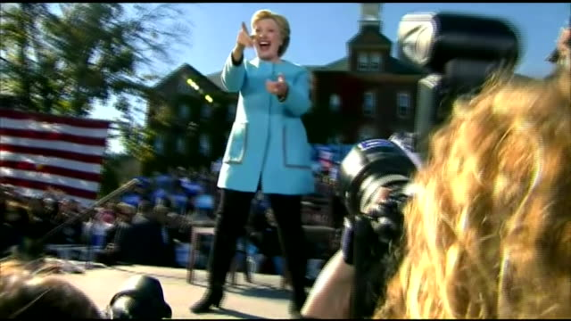 Hillary Clinton and Elizabeth Warren greeting supporters at a rally in New Hampshire