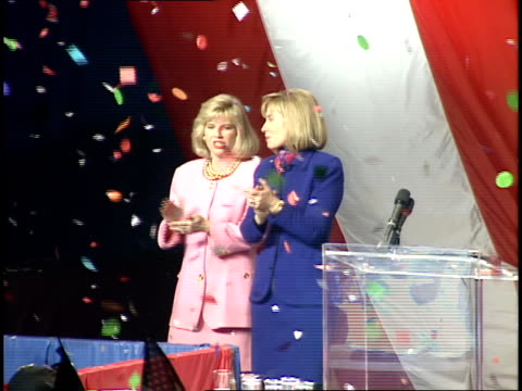 vídeos de stock e filmes b-roll de hillary clinton and tipper gore talking and waving on the stage with the cheering crowd at a rally following bill clinton's victory in the 1992... - 1992