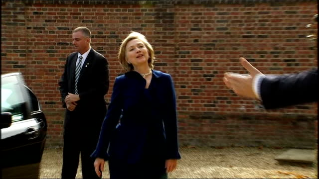 Hillary Clinton arrives at Chequers ENGLAND Buckinghamshire Chequers EXT Hillary Clinton motorcade arrives as Clinton out of car as enthusiastically...