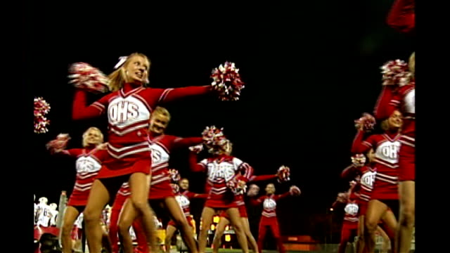 hillary clinton leads polls as likely democratic presidential candidate iowa school american football team practising on pitch cheerleaders... - パフォーマンス点の映像素材/bロール
