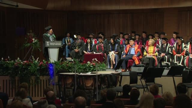 Hillary Clinton presented with honorary doctorate by Swansea University Hillary Clinton away from podium / receives standing ovation / Clinton...