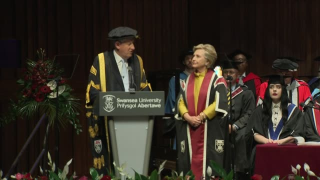Hillary Clinton presented with honorary doctorate by Swansea University WALES Swansea Swansea University EXT Car arriving and Hillary Clinton out and...
