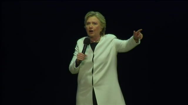 Hillary Clinton saying I want to hear you roar and sharing the stage with Katy Perry during a campaign rally in Philadelphia