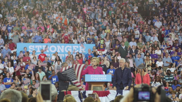 hillary clinton speaks during her first campaign stop after the democratic nomination in philadelphia, pennsylvania. seated are tim kaine, anne... - bill clinton stock videos & royalty-free footage