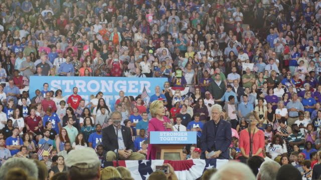 hillary clinton speaks during her first campaign stop after the democratic nomination in philadelphia, pennsylvania. seated are tim kaine, anne... - ペンシルベニア州点の映像素材/bロール