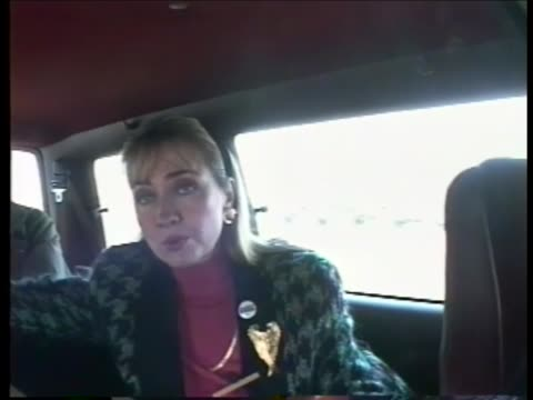 Hillary Clinton speaks to reports in campaign van speaks about unflattering news coverage