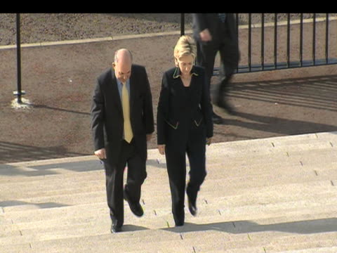 Hillary Clinton walks up stars to City Hall with Deputy Minister Martin McGuinness on first official visit to Northern Ireland as Secretary of State...