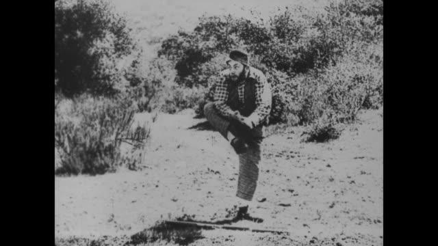 1918 hillbilly spits on hands and grabs rifle - ヒルビリー点の映像素材/bロール