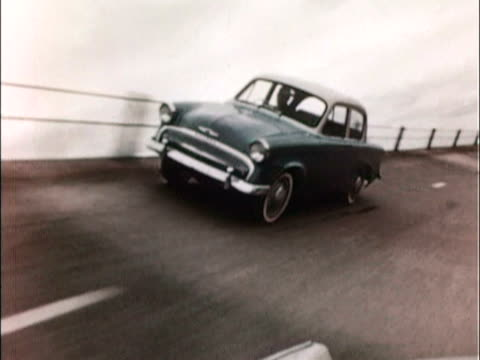 1957 ws ts 1957 hillman minx on banked test track / united kingdom - 1957 stock videos & royalty-free footage