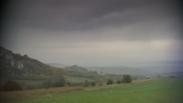 hills misty valley reverse pan valley under heavy cloud cover hazy xws falkenstein castle ruin on hilltop state of lower austria district of... - lower austria stock videos and b-roll footage