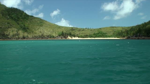 WS Hills on coast along bay, Whitsunday Islands, Queensland, Australia